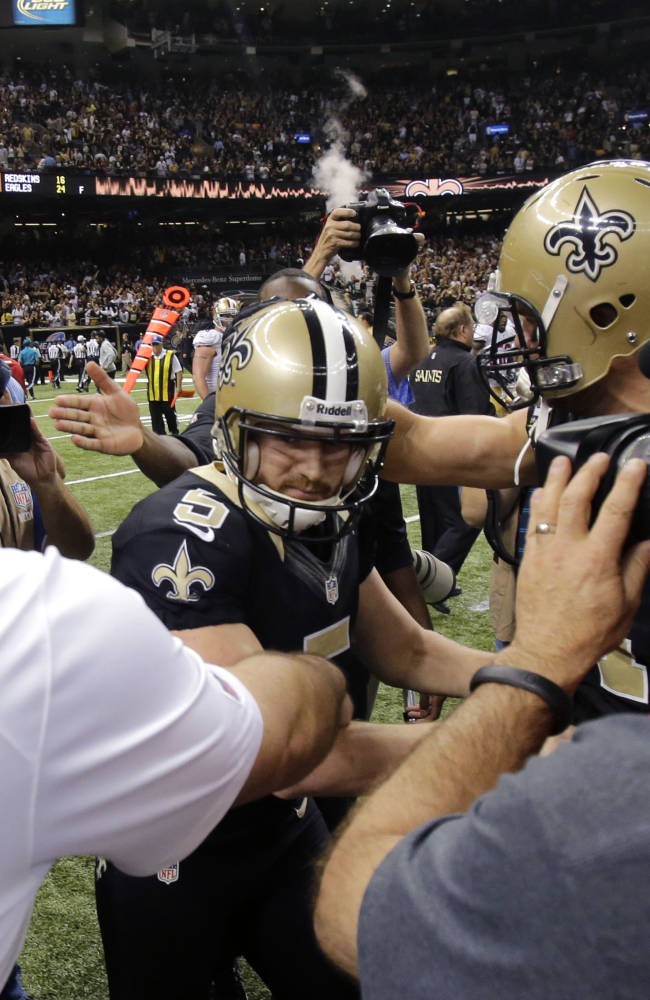 New Orleans Saints kicker Garrett Hartley (5) is congratulated after kicking the game winning field goal in the second half of an NFL football game against the San Francisco 49ers in New Orleans, Sunday, Nov. 17, 2013. The Saints won 23-20
