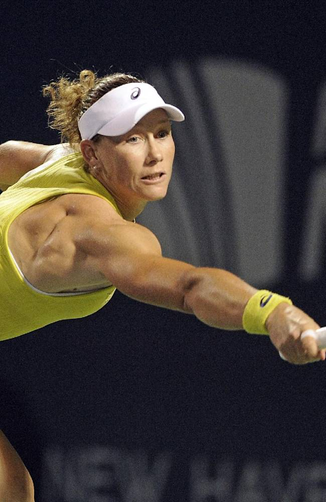Samantha Stosur, of Australia, reaches for a backhand during her 6-3, 4-6, 6-3, victory over Kirsten Flipkens, of Belgium, in a quarterfinal match at the New Haven Open tennis tournament in New Haven, Conn., on Thursday, Aug. 21, 2014