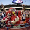 In this photo taken with a fisheye lens, football fans cheer before the start of an NFL football game between the Kansas City Chiefs and the New England Patriots at Arrowhead Stadium, Monday, Sept. 29, 2014, in Kansas City, Mo. (AP Photo/Charlie Riedel)