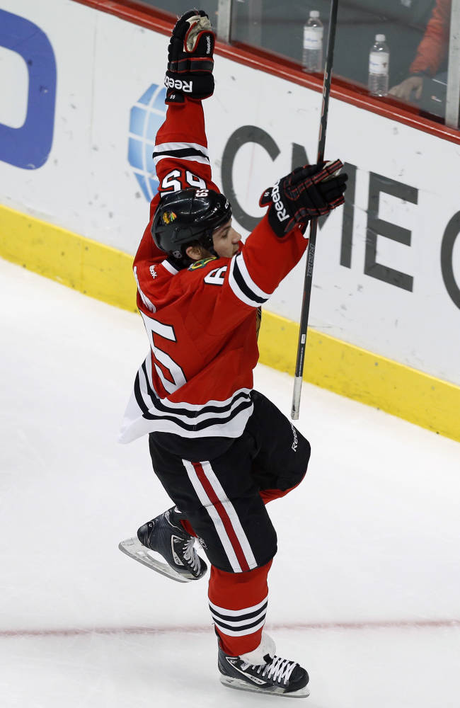 Kruger's goal helps Blackhawks edge Oilers 5-4