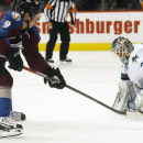 San Jose Sharks goalie Antti Niemi, right, of Finland, stops a shot off the stick of Colorado Avalanche center Matt Duchene in the shootout session to seal the Sharks' 3-2 shootout victory in an NHL hockey game in Denver on Tuesday, Oct. 28, 2014 The Asso