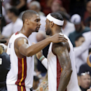 Miami Heat forward LeBron James, right, and center Chris Bosh hug after the Heat defeated the New York Knicks 102-91 in an NBA basketball game, Sunday, April 6, 2014, in Miami. James had 38 points and Bosh had 14 The Associated Press