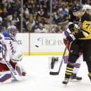 Pittsburgh Penguins' Evgeni Malkin (71) tries to deflect the puck past New York Rangers goalie Henrik Lundqvist (30) in the second period of an NHL hockey game, Saturday, Nov. 15, 2014, in Pittsburgh The Associated Press