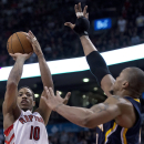 Toronto Raptors guard DeMar DeRozan shoots against Indiana Pacers forward David West during the second half of an NBA basketball game Friday, April 4, 2014, in Toronto The Associated Press
