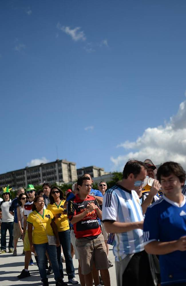 People wait to enter Maracana Stadium for the final World Cup soccer match between Argentina and Germany in Rio de Janeiro, Brazil, Sunday, July 13, 2014