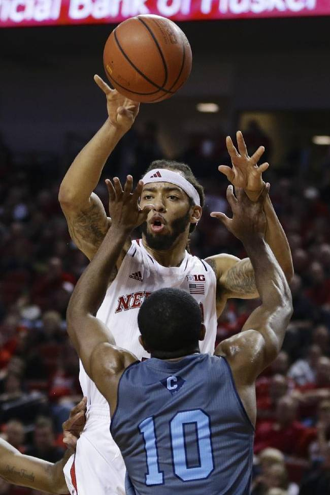 Nebraska's Terran Petteway passes the ball above The Citadel's Marshall Harris III (10) during the second half of an NCAA college basketball game in Lincoln, Neb., Saturday, Dec. 21, 2013. Nebraska won 77-62