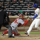 Washington Nationals catcher Jose Lobaton (59) tags New York Mets' Ruben Tejada, right, out a home plate in the fifth inning of a baseball game at Citi Field on Wednesday, April 2, 2014, in New York The Associated Press