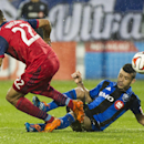 Montreal Impact's Felipe Martins, right, and Chicago Fire's Matt Watson vie for the ball during the second half of an MLS soccer game Saturday, Aug. 16, 2014, in Montreal The Associated Press