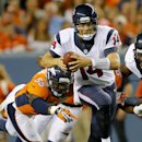 Houston Texans quarterback Ryan Fitzpatrick (14) escapes the reach of Denver Broncos outside linebacker Lerentee McCray (55) during the first half of an NFL preseason football game, Saturday, Aug. 23, 2014, in Denver The Associated Press