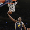 Utah Jazz's Alec Burks (10) drives past New York Knicks' J.R. Smith (8) during the first half of an NBA basketball game on Friday, March 7, 2014, in New York The Associated Press
