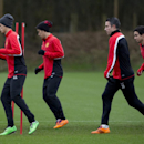 Manchester United's Adnan Januzaj, left, Shinji Kagawa, centre left, Robin van Persie and Rafael, right, train with teammates at Carrington training ground in Manchester, Monday, Feb. 24, 2014. Manchester United will play Olympiakos in a Champions League