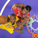 Los Angeles Lakers guard Jodie Meeks shoots as Houston Rockets forward Terrence Jones defends during the first half of an NBA basketball game, Tuesday, April 8, 2014, in Los Angeles The Associated Press