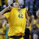 FILE - In this March 4, 2013, file photo, Baylor center Brittney Griner celebrates after she scored 50 points during the second half of an NCAA college basketball game against Kansas State, in Waco, Texas. Griner was selected as The Associated Press' women's college basketball player of the year on Saturday, April 6, 2013. (AP Photo/LM Otero, File)