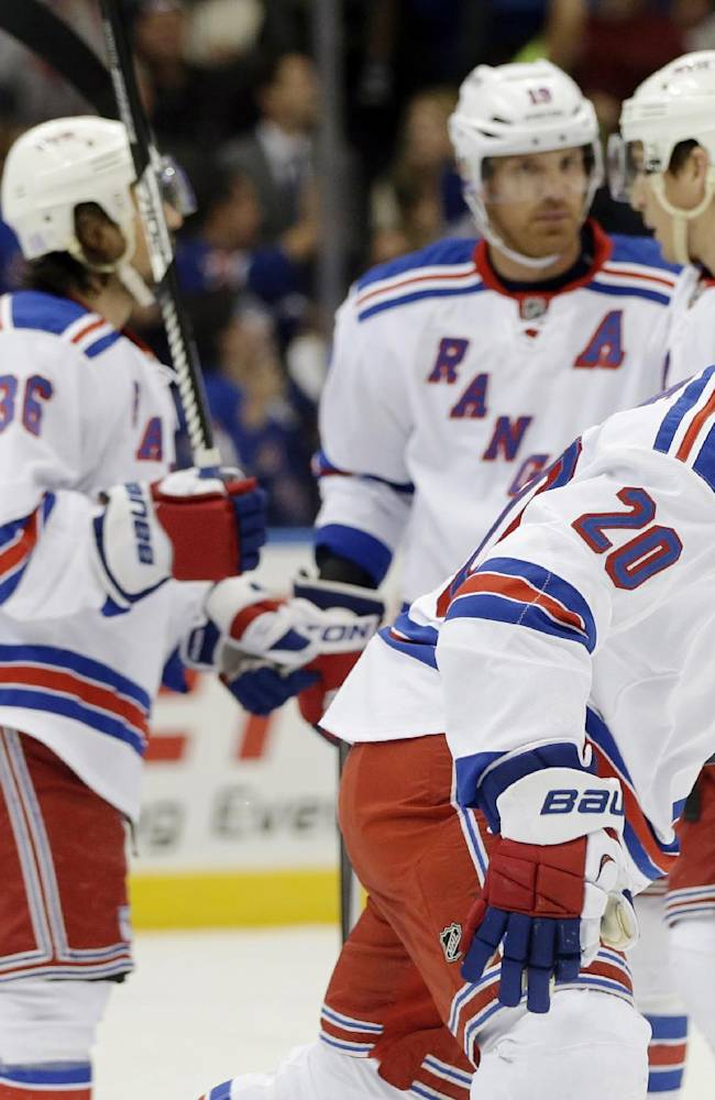 New York Rangers' Chris Kreider (20) skates toward his bench after scoring a goal during the first period of an NHL hockey game against the New York Islanders Tuesday, Oct. 29, 2013, in Uniondale, N.Y