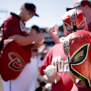 Baylor DeBusk, 8, right, waits for Arizona Diamondbacks players autographs before a spring training baseball game against the San Diego Padres in Scottsdale, Ariz., Sunday, March 9, 2014 The Associated Press