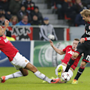 Manchester United s Rio Ferdinand, left, and Phil Jones challenge Leverkusen s Stefan Kiessling during the Champions League group A soccer match between Bayer Leverkusen and Manchester United in Leverkusen, Germany, Wednesday, Nov. 27, 2013