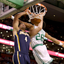 Indiana Pacers power forward Luis Scola (4), of Argentina, dunks the ball as Boston Celtics point guard Phil Pressey (26) tries to block the shot during the first half of an NBA basketball game on Saturday, March 1, 2014, in Boston The Associated Press