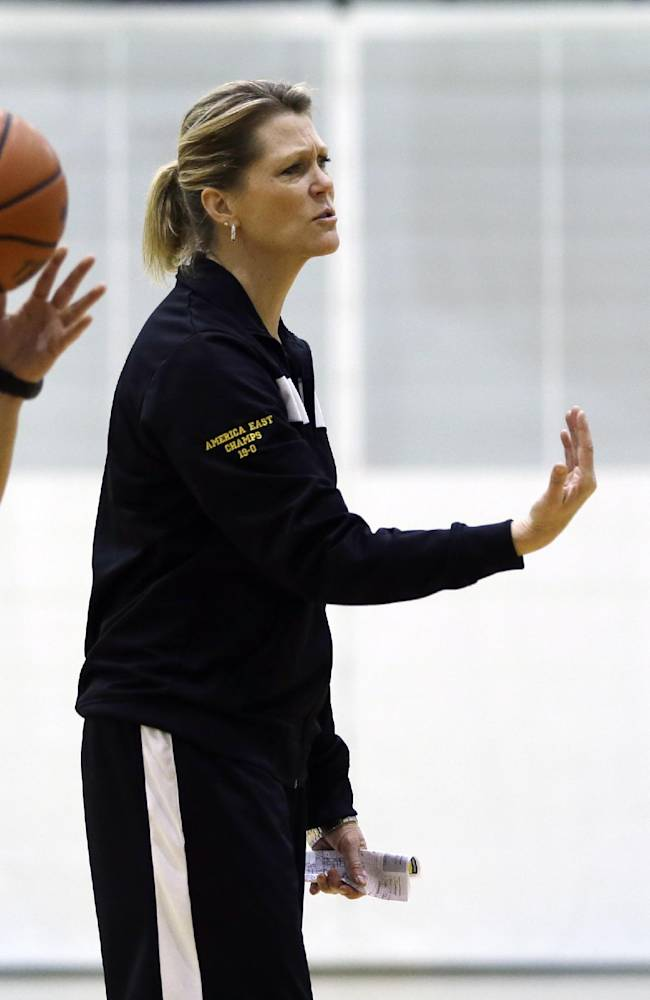 In this Feb. 18, 2014 photo, University at Albany head coach  Katie Abrahamson-Henderson talks to players during NCAA college basketball practice at SEFCU Arena, in Albany, N.Y