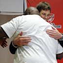 New England Patriots quarterback Tom Brady, left, hugs defensive lineman Vince Wilfork during a press conference after the NFL football AFC Championship game against the Indianapolis Colts Sunday, Jan. 18, 2015, in Foxborough, Mass. The Patriots defeated
