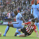 Manchester City's Eliaquim Mangala, left, fouls Southampton's Shane Long before being sent-off during their English Premier League match at St Mary's Stadium, Southampton England Sunday Nov. 30, 2014