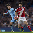 Manchester City's David Silva, left, fights for the ball against Middlesbrough's George Friend during the English FA Cup fourth round soccer match between Manchester City and Middlesbrough at the Etihad Stadium, Manchester, England, Saturday, Jan. 24, 201