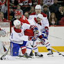 Carolina Hurricanes' Andrej Sekera, of Slovakia, looks for the puck as Montreal Canadiens' Ryan White (53) clears the puck away while Canadiens' Max Pacioretty (67) and Andrei Markov (79), of Russia, watch at rear during the first period of an NHL hockey