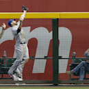 New York Mets' Andrew Brown makes a jumping catch on a fly ball hit by Arizona Diamondbacks' Miguel Montero during the seventh inning of a baseball game on Wednesday, April 16, 2014, in Phoenix. The Mets defeated the Diamondbacks 5-2 The Associated Press