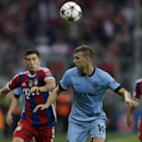 Bayern's Robert Lewandowski, left, and Manchester City's Edin Dzeko challenge for the ball during the Champions League Group E soccer match between FC Bayern Munich and Manchester City at Allianz Arena in Munich, southern Germany, Wednesday Sept. 17, 201