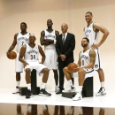 Brooklyn Nets' Joe Johnson, from left, Paul Pierce, Kevin Garnett, head coach Jason Kidd, Deron Williams and Brook Lopez pose for a photo during the team's NBA basketball media day at the Barclays Center in the Brooklyn borough of New York, Monday, Sept. 30, 2013. (AP Photo/Stuart Ramson)