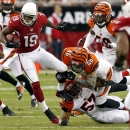 Arizona Cardinals wide receiver Ted Ginn Jr. (19) is tripped up by -Cincinnati Bengals' Clark Harris (46) and Vincent Rey during the first half of an NFL preseason football game, Sunday, Aug. 24, 2014, in Glendale, Ariz The Associated Press