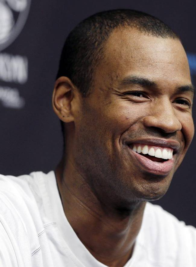 Brooklyn Nets Jason Collins speaks during a news conference before an NBA basketball game against the Chicago Bulls at the Barclays Center, Monday, March 3, 2014, in New York. More than a week after becoming the league's first openly gay player, Collins will finally get to play a home game Monday night