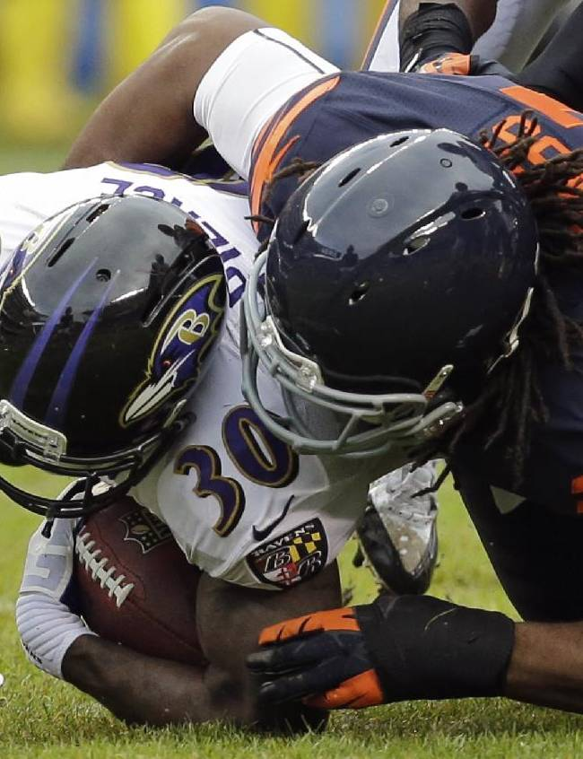 Chicago Bears defensive end David Bass (91) tackles Baltimore Ravens running back Bernard Pierce (30) during the first half of an NFL football game, Sunday, Nov. 17, 2013, in Chicago