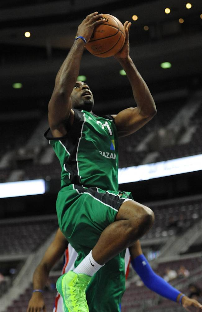Maccabi Haifa forward Ike Ofoegbu (21) goes in for a layup against the Detroit Pistons during the first quarter of an NBA preseason basketball game at the Palace of Auburn Hills, Mich., Tuesday, Oct. 8, 2013