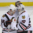 Chicago Black Hawks right winger Ben Smith (28) celebrates with goaltender Corey Crawford (50) after an NHL hockey game against the Buffalo Sabres in Buffalo, N.Y., Sunday, March 9, 2014. Chicago won 2-1 The Associated Press
