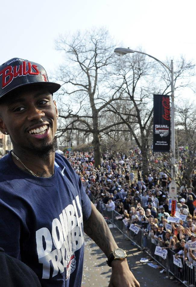 Connecticut's Ryan Boatright smiles during a parade celebrating the men's basketball team's victory in the NCAA tournament, in Hartford, Conn., on Sunday, April 13, 2014