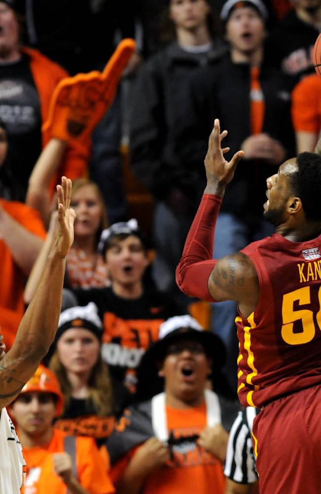 Iowa State guard DeAndre Kane, right, takes a shot over Oklahoma State Le'Bryan Nash, left, during an NCAA college basketball game in Stillwater, Okla., Monday, Feb. 3, 2014. Kane scored 26 points in the 98-97 triple overtime win over Oklahoma State