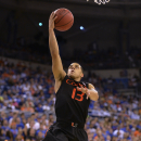 Miami guard Angel Rodriguez (13) goes up for two his his game high 24 points against Florida during the second half of an NCAA College basketball in Gainesville, Fla., Monday, Nov. 17, 2014. Miami defeated Florida 69-67. (AP Photo/Phil Sandlin)