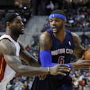 Miami Heat small forward LeBron James, left, defends Detroit Pistons small forward Josh Smith (6) in the second quarter of an NBA basketball game in Auburn Hills, Mich., Sunday, Dec. 8, 2013 The Associated Press