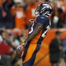 Denver Broncos running back Ronnie Hillman celebrates his touchdown run against the San Francisco 49ers during the second half of an NFL football game, Sunday, Oct. 19, 2014, in Denver. (AP Photo/Joe Mahoney)