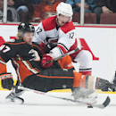 The Ducks' Hampus Lindholm is checked by the Hurricanes' Eric Staal during the first period of their hockey game at Honda Center Tuesday night Feb. 3, 2015 The Associated Press