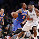 New York Knicks guard J.R. Smith (8) drives up against Brooklyn Nets shooting guard Joe Johnson (7) in the first half of their NBA basketball game at the Barclays Center, Thursday, Dec. 5, 2013, in New York.The Knicks defeated the Nets 113-83 The Associat