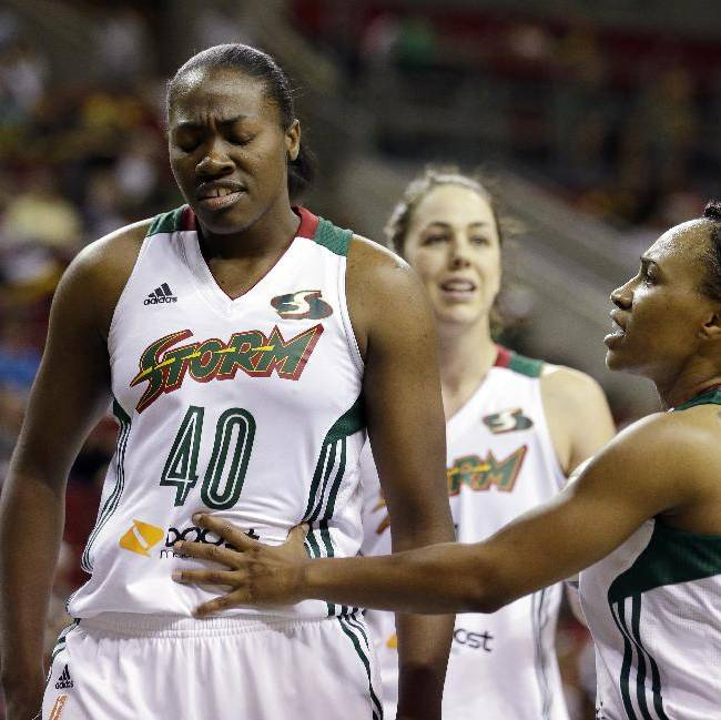 Seattle Storm's Temeka Johnson, right, talks with Shekinna Stricklen (40) after Stricklen fouled a Los Angeles Sparks player in the second half of a WNBA basketball game Friday, May 16, 2014, in Seattle. The Sparks won 80-69