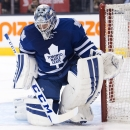 The puck gets past Toronto Maple Leafs goaltender Jonathan Bernier for a goal during the first period of an NHL hockey game against the Pittsburgh Penguins, Saturday, Oct. 11, 2014 in Toronto The Associated Press