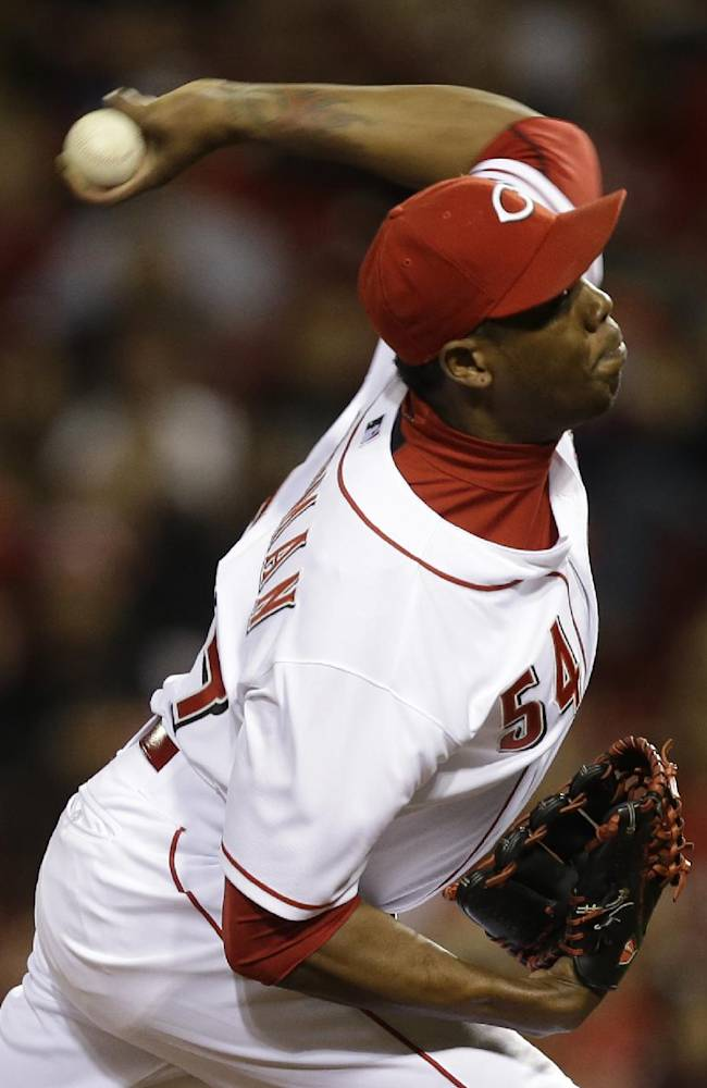 Cincinnati Reds relief pitcher Aroldis Chapman throws against the New York Mets in the ninth inning of a baseball game, Monday, Sept. 23, 2013, in Cincinnati