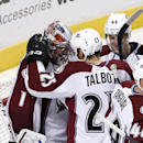 Colorado Avalanche center Maxime Talbot (25) celebrates with goalie Semyon Varlamov (1) the Avalanche's 2-0 win over the Chicago Blackhawks after an NHL hockey game Tuesday, Jan. 6, 2015, in Chicago The Associated Press
