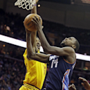 Charlotte Bobcats' Michael Kidd-Gilchrist (14) goes up to shoot against Cleveland Cavaliers' Tristan Thompson in the first quarter of an NBA basketball game on Saturday, April 5, 2014, in Cleveland The Associated Press