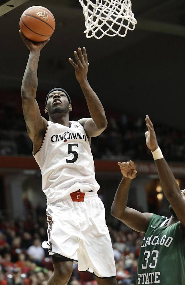 Cincinnati forward Justin Jackson (5) shoots against Chicago State forward Quinton Pippen (33) during the first half of an NCAA college basketball game, Monday, Dec. 23, 2013, in Cincinnati