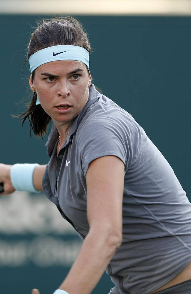 Ajla Tomljanovic, of Croatia, returns to Jelena Jankovic, of Serbia, at the Family Circle Cup tennis tournament in Charleston, S.C., Thursday, April 3, 2014