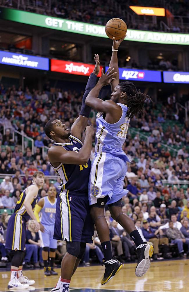 Denver Nuggets' Kenneth Faried (35) shoots as Utah Jazz's Derrick Favors, right, defends in the first quarter during an NBA basketball game Monday, Nov. 11, 2013, in Salt Lake City