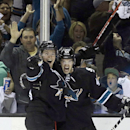 San Jose Sharks' Marc-Edouard Vlasic (44) celebrates with Joe Pavelski, left, after Vlasic scored against the Los Angeles Kings during the second period of Game 1 of an NHL hockey first-round playoff series Thursday, April 17, 2014, in San Jose, Calif The